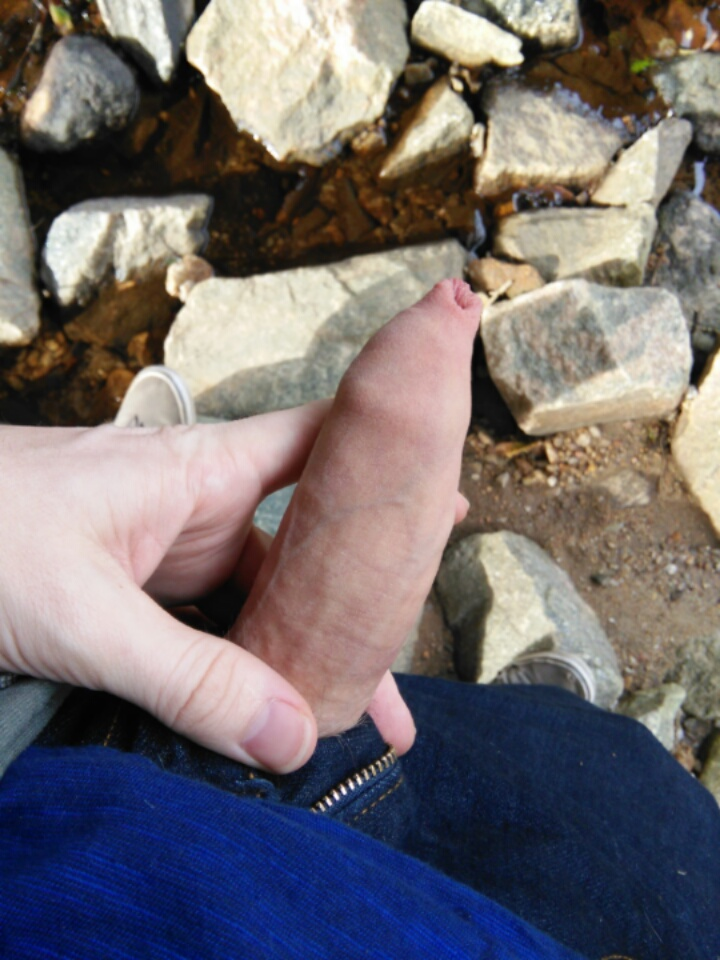 Showing uncut cock outdoors