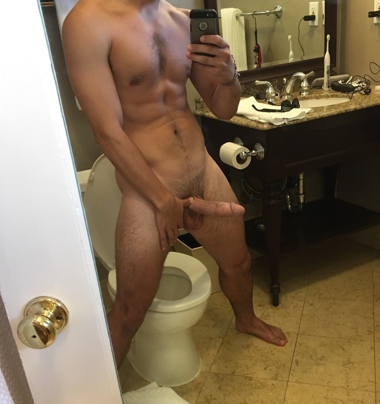 Naked guy with an erection — pic 1